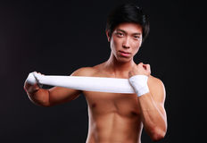 Boxer preparing for a fight. Bandaging his hands stock photo