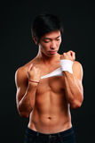 Boxer preparing for a fight. Bandaging his hands stock images
