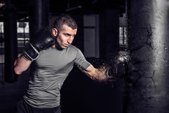 Boxer punch punching bag exploding in gym Royalty Free Stock Photo