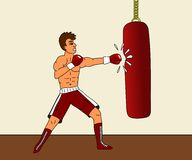 Boxer and punching bag Royalty Free Stock Image