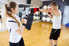 Boxer Punching Bag Held By Female Instructor Stock Images