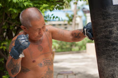 Boxer punching the sandbag Royalty Free Stock Photography