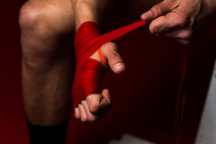 Boxer Putting On Straps Preparing For Combat Royalty Free Stock Photography