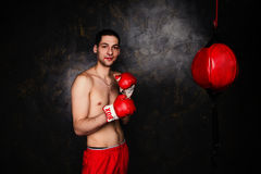 Boxer with red gloves in dark room Royalty Free Stock Photos