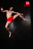 Boxer with red gloves in dark room Royalty Free Stock Photography