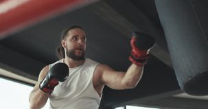 Boxer in the ring, practice the technique of strikes, rack, defense and endurance, wet on the training stock image