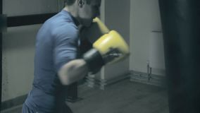 Boxer in the ring trains fast punches. preparing for the battle. Dark background.  stock video