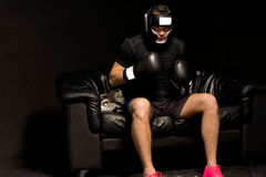 Boxer sitting on a couch getting ready for a fight Royalty Free Stock Images