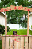 Boxer sitting in a kissing booth Royalty Free Stock Photography