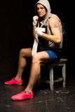Boxer sitting on a stool waiting for his fight Stock Photography
