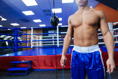 Boxer standing near boxing ring Stock Photography