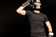 Boxer standing raising his fist to his head Stock Photo