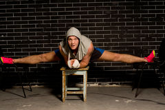 Boxer stretching and strengthening his leg muscles Stock Images