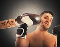 Boxer with taxes tattoo. Boxer receives punch from boxer with tattoo Stock Photo