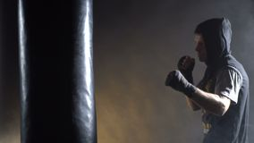 Boxer training in the gym. On a dark background stock video footage