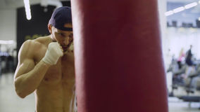 Boxer training punching bag Royalty Free Stock Images
