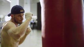 Boxer training punching bag Royalty Free Stock Photos