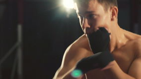 Boxer training with punching bag in the gym stock video footage