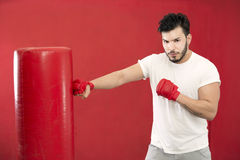 Boxer in training on a punching bag Royalty Free Stock Photo
