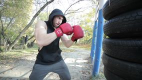 Boxer trains in a sports park. stock footage