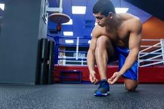Boxer tying shoelaces Royalty Free Stock Photo