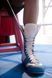 Boxer wearing shoes in boxing ring Stock Photo