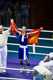 Boxer wears flag after winning gold. Mongolian boxer Badar-Uugan Enkhbat wears the Mongolian flag after defeating  Yankiel Leon Alarcon of Cuba in the men�s Royalty Free Stock Photography