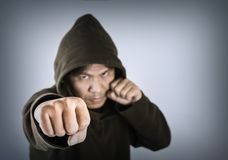 Boxer wears a hood Fighting punch, concept of fighting stock photos