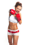 Boxer woman during boxing exercise making direct hit with red gl Stock Photo