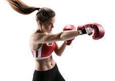 Boxer woman during boxing exercise making direct hit with red glove Royalty Free Stock Photo