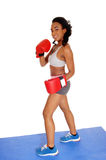 Boxer woman during boxing exercise. Stock Image
