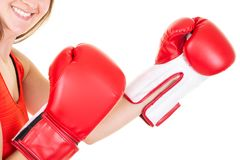 Boxer woman closeup during boxing exercise making direct hit with glove. A Boxer woman closeup during boxing exercise making direct hit with glove royalty free stock image