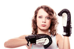 Boxer woman in gloves training kick boxing. Stock Images