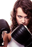 Boxer woman in gloves training kick boxing. Stock Photo
