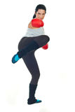 Boxer woman kicking Stock Photos