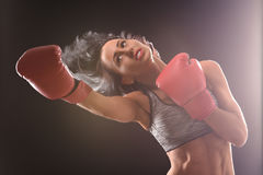 Boxer woman with red boxing gloves on Royalty Free Stock Photos