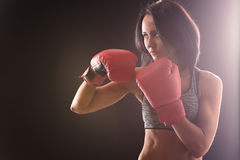 Boxer woman with red boxing gloves on Stock Photography