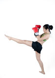 Boxer Woman With Red Glove. Young Boxer Woman With Red Glove practice kicking Royalty Free Stock Images