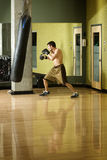 Boxer working out on punching bag Royalty Free Stock Photos