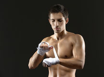 Boxer wraps hands with protective bandage Royalty Free Stock Photo