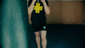 Boxer. Young  training at the punching bag stock video footage