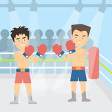 Boxers fighting at the court. Two young male boxers are fighting with gloves. Boxing ring Stock Photography