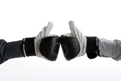 Boxers gloves. Bussinesman hands touching with boxing gloves Royalty Free Stock Photos