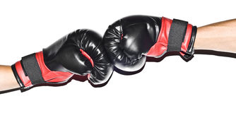 Boxers gloves isolated. Two people hitting each other with boxers gloves, hands isolated on white background Stock Photo
