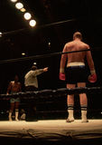 Boxers. Heavyweight boxers preparing to square off for a ten round match Stock Image