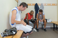 Boxers resting locker room. Boxers resting the locker room Stock Images