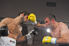 Boxers in the ring during fight for ranking points. Kyiv, Ukraine - December 24, 2016: An unidentified boxers in the ring during fight for ranking points in the Stock Photo