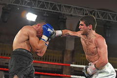Boxers in the ring during fight for ranking points. Kyiv, Ukraine - December 24, 2016: An unidentified boxers in the ring during fight for ranking points in the Royalty Free Stock Photo