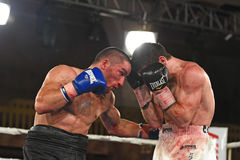 Boxers in the ring during fight for ranking points. Kyiv, Ukraine - December 24, 2016: An unidentified boxers in the ring during fight for ranking points in the Royalty Free Stock Image