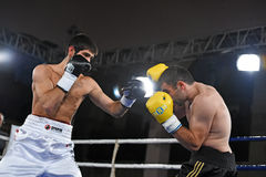 Boxers in the ring during fight for ranking points. Kyiv, Ukraine - December 24, 2016: An unidentified boxers in the ring during fight for ranking points in the Royalty Free Stock Photos